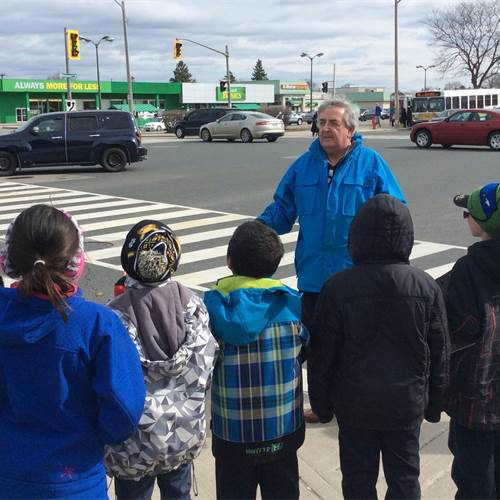 Dr. Denis Corr leads Grade 4 and 5 students from Regina Mundi on a neighbourhood walk to test air quality levels and determine the cleanest routes to school.
